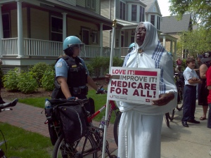 Ronald Jackson stands outside Mayor Rahm Emanuel's home during a protest