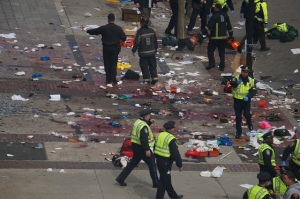 "The after math of the Boston Marathon bombings, three reported dead, one an 8-year-old boy. (Aaron ""tango"" Tang/ Flickr)"