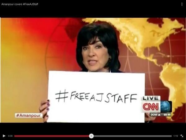 Christiane Amanpour (@camanpour) holds up #FreeAJStaff sign on-air. @OsamaSaeed / Via twtrland.com