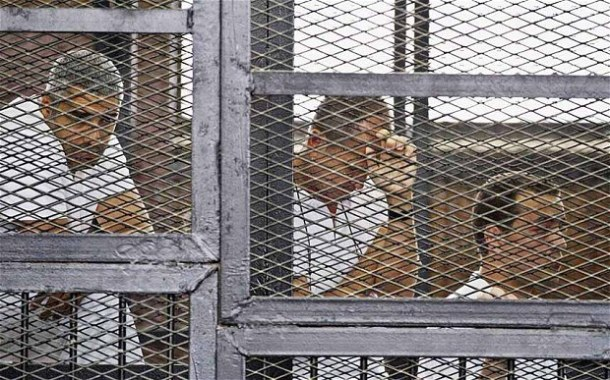 From left: Mohammed Fahmy, Peter Greste, and Baher Mohamed during their trial on terror charges at a courtroom in Cairo in May. AP / Via telegraph.co.uk